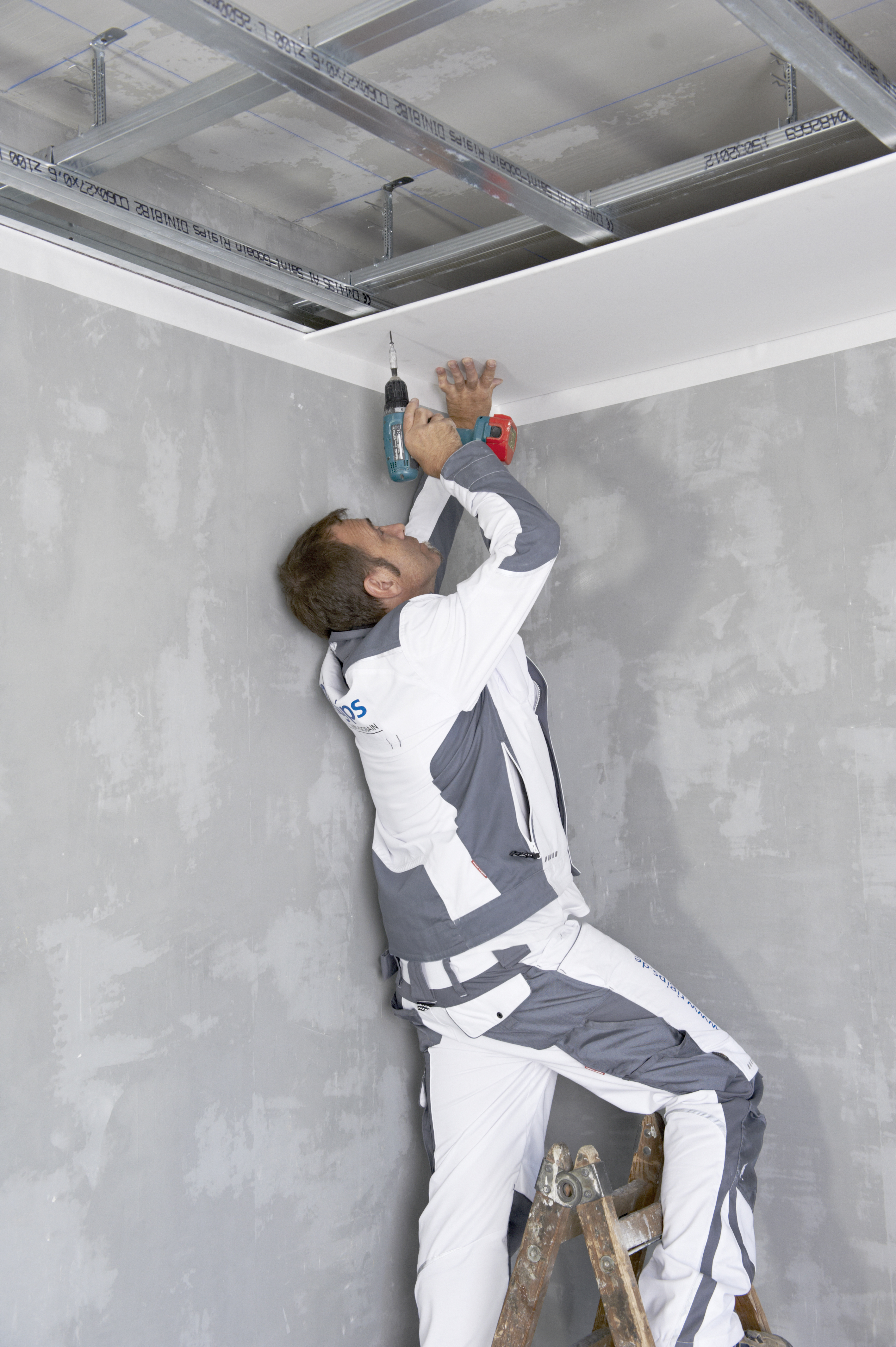A handyman installing the ceiling